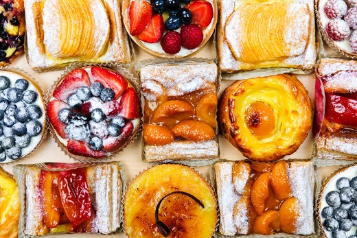 Background of assorted fresh sweet tarts and pastries from above : Stock Photo