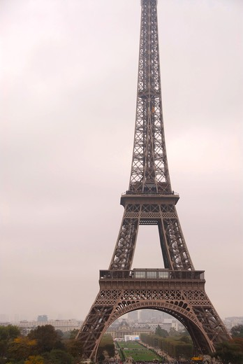Stock Photo: 4183R-4817 Eiffel tower on a foggy day in Paris France