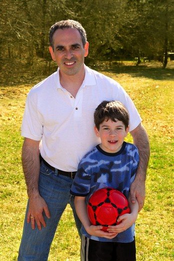 Stock Photo: 4183R-5270 Portrait of father and son playing outdoors