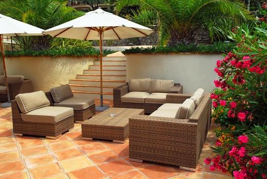 Stock Photo: 4183R-5503 Patio of mediterranean villa in French Riviera with wicker furniture