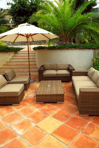 Stock Photo: 4183R-5504 Patio of mediterranean villa in French Riviera with wicker furniture