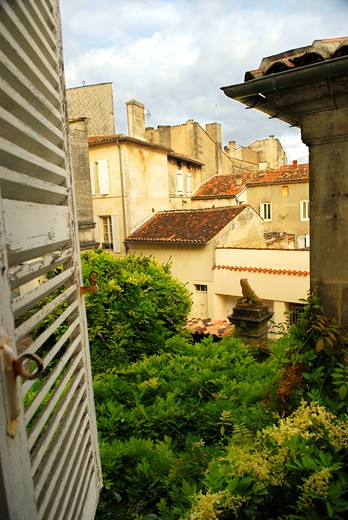 View from an open window with shutters in town of Cognac, France : Stock Photo