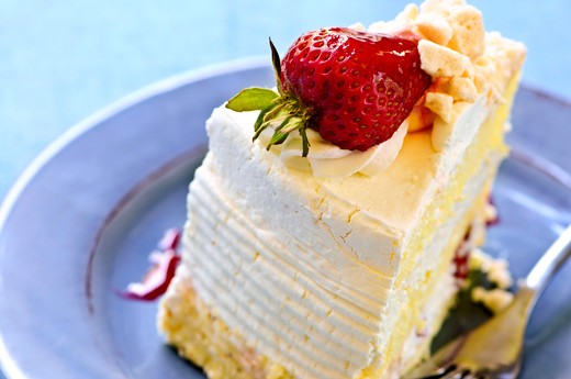 Stock Photo: 4183R-565 Slice of strawberry meringue cake on a plate