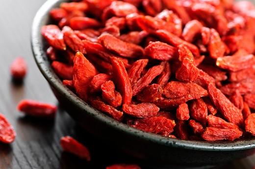 Full bowl of red dried goji berries : Stock Photo