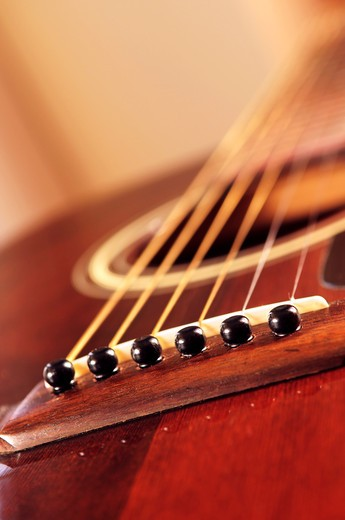 Stock Photo: 4183R-6346 Musical instrument acoustic guitar close up in perspective