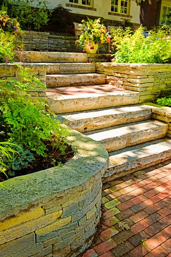 Natural stone landscaping in home garden with stairs : Stock Photo