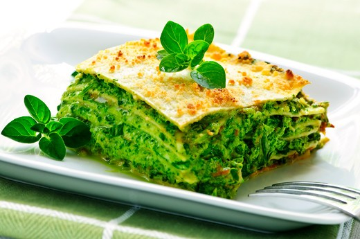 Serving of fresh baked vegeterian spinach lasagna on a plate : Stock Photo
