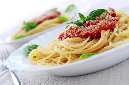 Stock Photo: 4183R-8235 Pasta with tomato sauce basil and grated parmesan