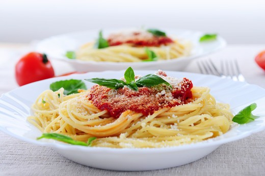 Stock Photo: 4183R-8241 Pasta with tomato sauce basil and grated parmesan