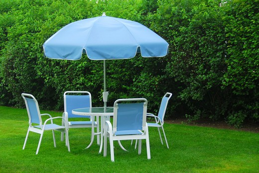 Stock Photo: 4183R-8264 Patio furniture on green lawn