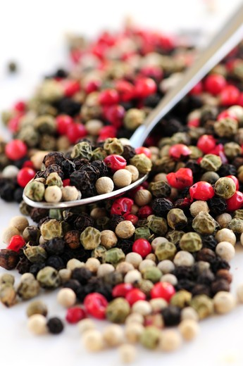 Stock Photo: 4183R-8335 Mixed assorted peppercorns on white background macro