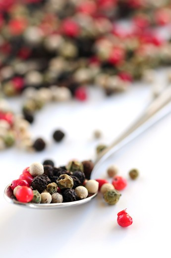Mixed assorted peppercorns on white background macro : Stock Photo