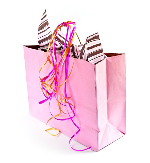 Pink shopping bag with ribbons isolated on white background : Stock Photo