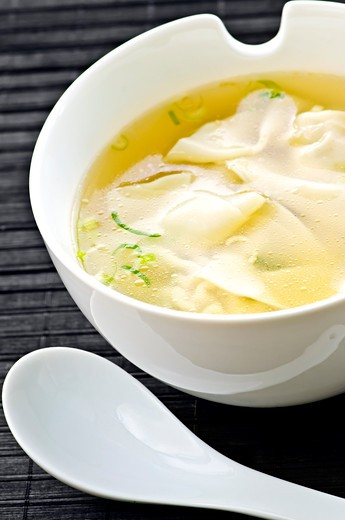 Stock Photo: 4183R-9300 Wonton soup in white bowl with spoon