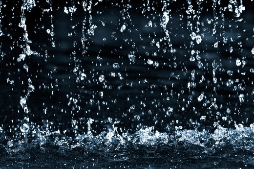 Stock Photo: 4183R-964 Falling water drops on dark background close up