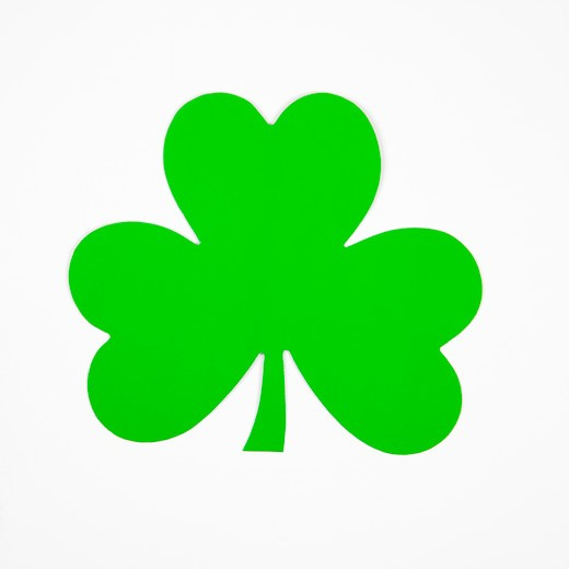 Single green paper shamrock on white. : Stock Photo