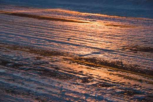 Close up of ice covered road with tire marks. : Stock Photo