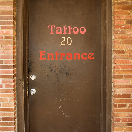 Stock Photo: 4184R-12245 Doorway entrance to tattoo parlor.