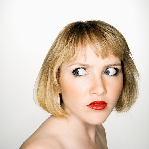 Stock Photo: 4184R-12583 Portrait of young blonde caucasian woman who has suspicious expression.