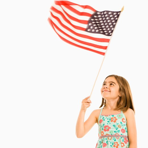 Girl holding American flag against white background. : Stock Photo