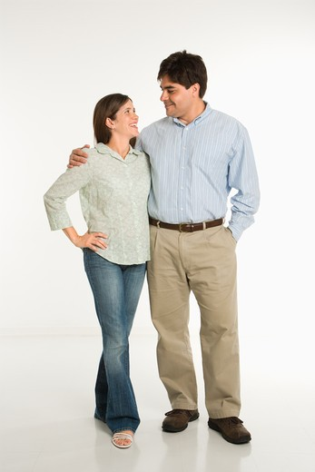 Full length portrait of couple standing smiling against white background. : Stock Photo