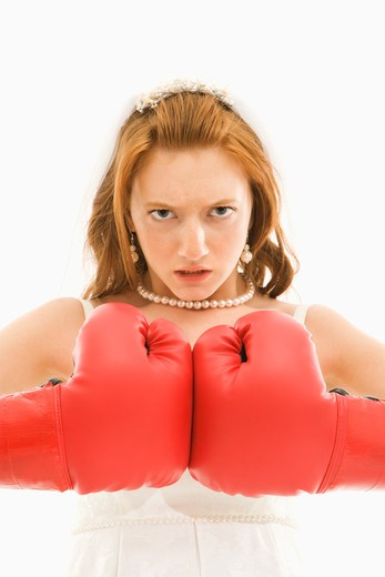 Caucasian bride with boxing gloves togther. : Stock Photo