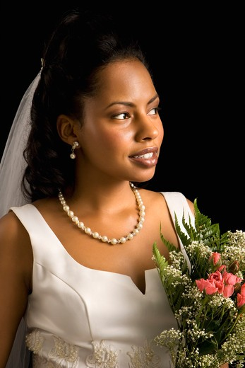 Portrait of a mid-adult African-American bride on black background. : Stock Photo
