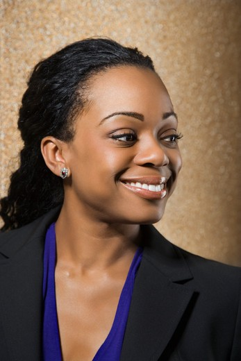 Stock Photo: 4184R-13389 Pretty African American businesswoman smiling.