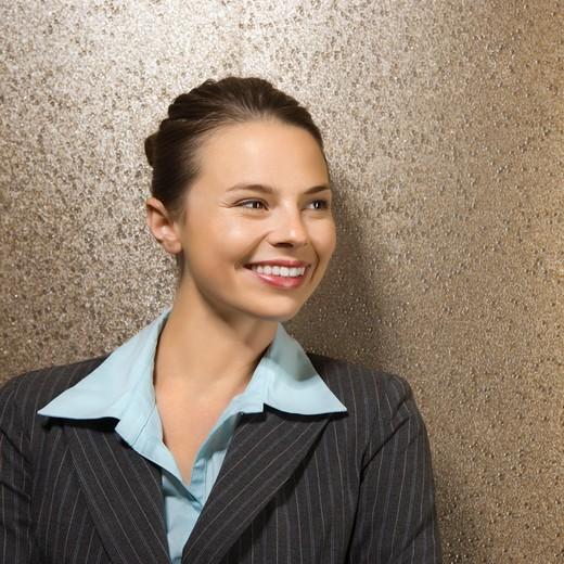 Stock Photo: 4184R-13391 Pretty Caucasian businesswoman smiling.
