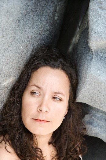 Portrait of brunette Caucasian mid-adult woman by rock formation. : Stock Photo