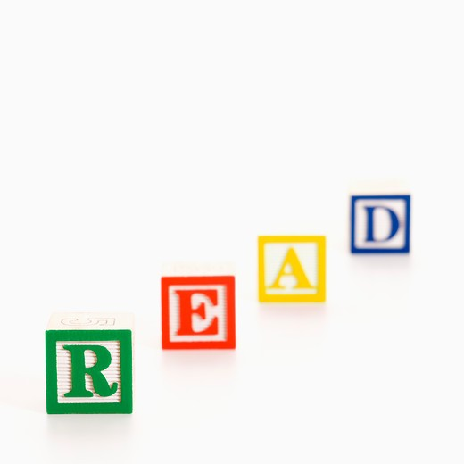 Alphabet toy building blocks spelling the word read. : Stock Photo