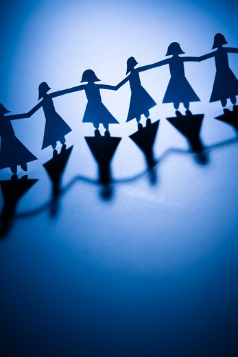 Stock Photo: 4184R-13864 Cutout paper females standing holding hands.