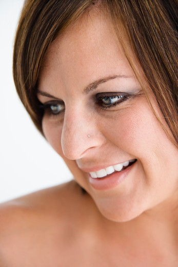 Stock Photo: 4184R-14392 Bare Caucasian mid adult brunette woman looking to side and smiling.