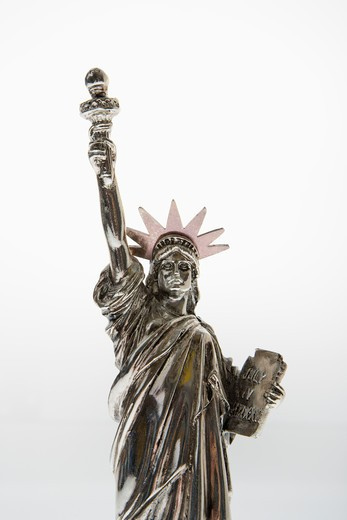 Statue of Liberty reproduction on white background. : Stock Photo