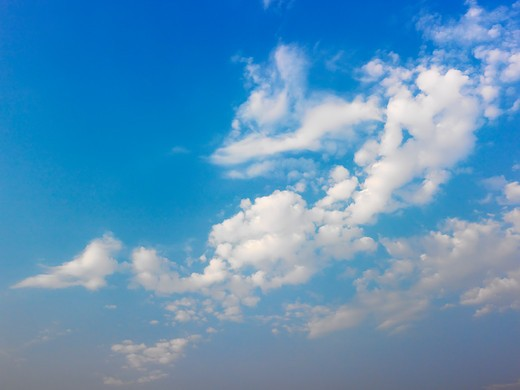 Skyscape of blue sky and white fluffy clouds. : Stock Photo