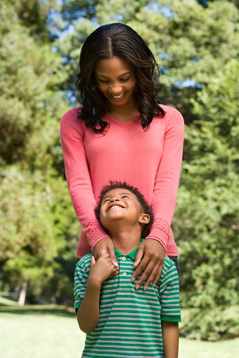 Stock Photo: 4184R-15413 Mother and son looking at eachother smiling.