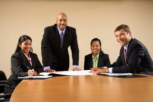 Businesspeople having meeting at conference table. : Stock Photo