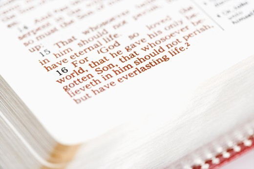 Stock Photo: 4184R-16145 Selective focus of verses in open Holy Bible.