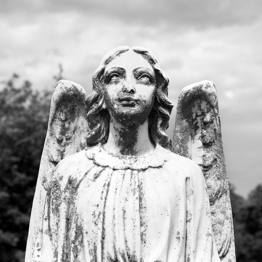 Guardian Angel statue in graveyard. : Stock Photo