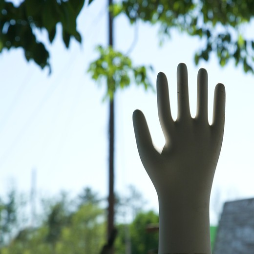 Hand statue silhouetted against sky. : Stock Photo