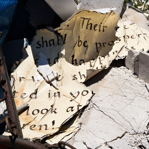 Stock Photo: 4184R-17002 Pages of old weathered bible verse lying in junkyard.