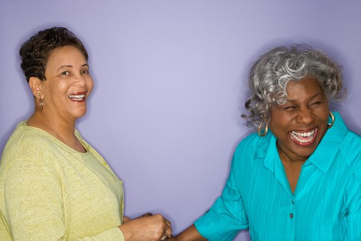 Mature adult African American females laughing. : Stock Photo