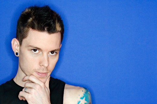 Stock Photo: 4184R-3247 Young adult Caucasian male pierced ear and tattoo.