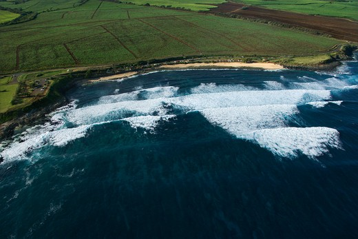 Stock Photo: 4184R-4296 Aerial view of surf spot on coast of Maui, Hawaii with waves.