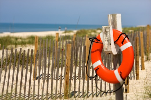 Stock Photo: 4184R-4356 Life preserver hanging on post on beach on Bald Head Island, North Carolina.
