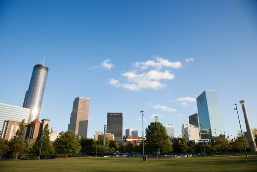 Stock Photo: 4184R-6597 Skyline behind Centennial Olympic Park in downtown Atlanta, Georgia.