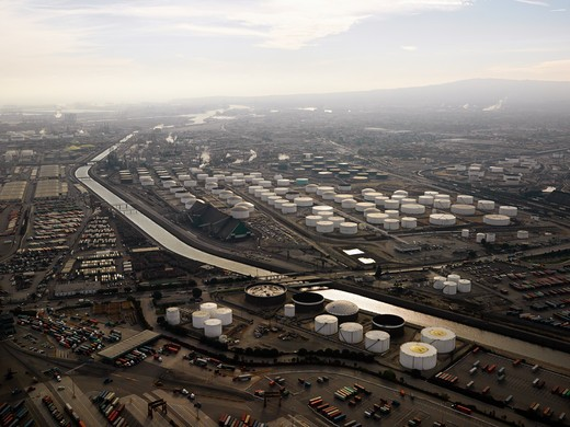 Stock Photo: 4184R-7202 Aerial view of liquid storage tanks in Los Angeles California oil refinery.