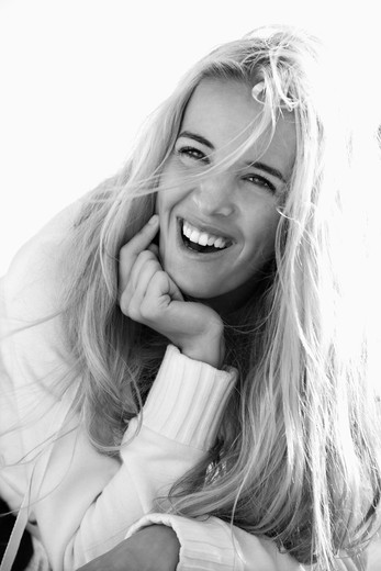 Black and white head and shoulder portrait of pretty blond Caucasian woman smiling and laughing. : Stock Photo