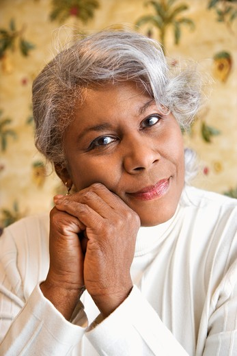 Stock Photo: 4184R-781 Portrait of mature African American woman looking at viewer.