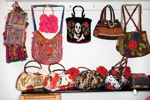 Unique handbags hanging in retail store. : Stock Photo